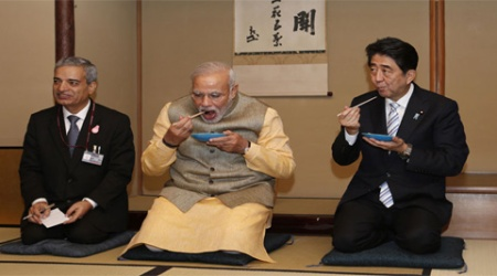 Prime Minister Narendra Modi and his Japanese counterpart Shinzo Abe eat tea cakes at the Omotesenke tea hut, one of the main schools for the Japanese tea ceremony, in Tokyo on Monday. (Source: Reuters)