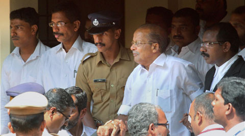 CPI (M) leader Kunjananthan, one of the convicts in TP Chandrashekaran''s murder case, is escorted at the special Additional Sessions Court.