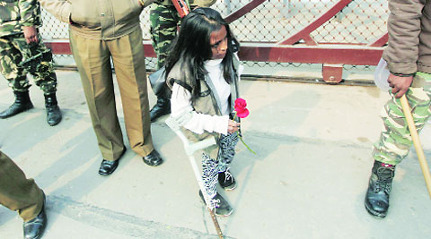A woman waits with a rose for the CM. (IE Photo: Tashi Tobgyal)