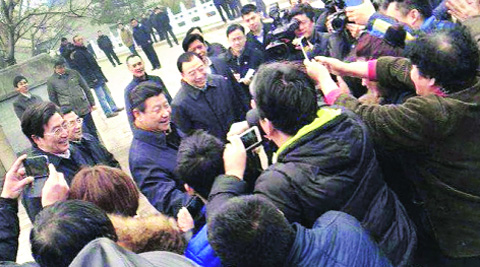 Chinese President Xi Jinping is surrounded by onlookers in Beijing Tuesday.