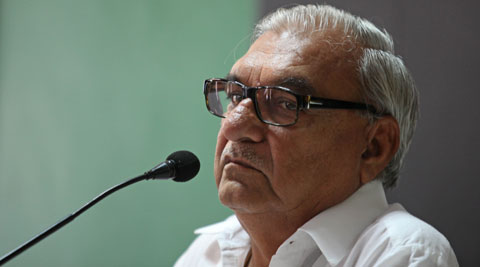 Hooda, who was taken aback, pushed the youth, attired in blue jeans and a brown jacket, back. (Express Archive)