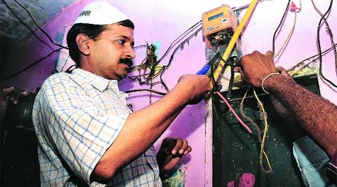 "Arvind Kejriwal cutting the power connection in a house during the ""bijli-paani andolan"" last year. (Express archive)"