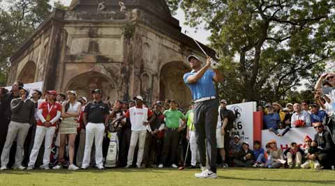 Legendary golfer Tiger Woods tees off amid during an exhibition match at the Delhi Golf Club. PTI photo