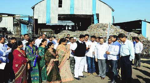 Mayor Chanchala Kodre and Municipal Commissioner Vikas Deshmukh along with other civic officers interact with residents of Uruli Devachi on Wednesday. (Express)