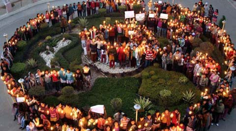 People holding a candlelight vigil in support of the Delhi rape victim.