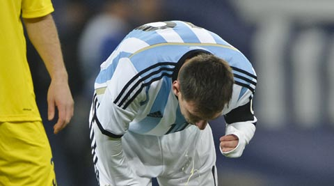 Lionel Messi vomits during the friendly game against Romania in Bucharest on Wednesday (AP)