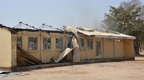 The remains of the burned out Federal Government College in Buni Yadi, Nigeria, Tuesday, Feb. 25, 2014. Islamic militants killed at least 29 students in a pre-dawn attack Tuesday on the northeast Nigerian school, survivors said, setting ablaze a locked dormitory and shooting and slitting the throats of those who escaped through windows. Some were burned alive. (AP Photo)