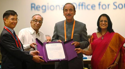 Chairperson, South-East Asia Regional Certification Commission for Polio Eradication Supamit Chunsuttiwat, left, and WHO's South-east Asian region Regional Director Poonam Khetrapal, right, give polio free certification to  Health Minister Ghulam Nabi Azad on Thursday. (AP)