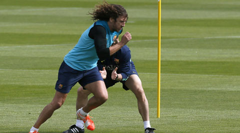 Barca's captain Carles Puyol, who has been injured for a majority of the season, has been included in the squad to face Madrid in the King's Cup final in Valencia. (Reuters)