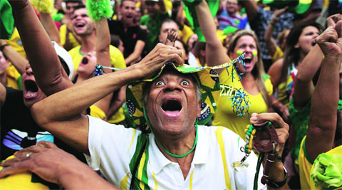 Brazilian fans celebrate after their side beat Chile on penalties in a Round of 16 match at the World Cup (Source: AP)