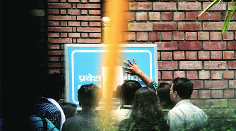 Students look at a notice put up at Delhi University. (Source: Express photo by Praveen Khanna)