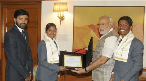 Prime Minister with teenaged mountaineers Poorna Malavath and Anand Kumar  in New Delhi on Friday. Their coach Shekhar Babu is also seen. (Source: PTI Photo)