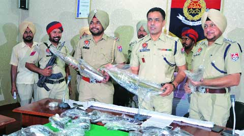 ADCP Satvir Atwal (centre) with the seizure of weapons in Ludhiana on Monday. ( Source: Express photo by Gurmeet Singh).