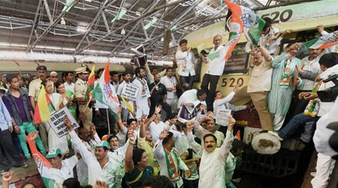 Congress workers protesting against the Union government over proposed hike in railway fares. (Source: PTI)