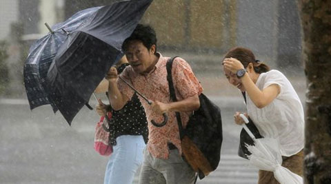 The storm was downgraded from a typhoon after sweeping past Tokyo. (Source: AP photo)