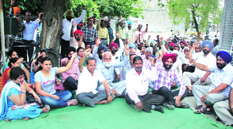 PSPCL employees protest against police inaction  in Ludhiana on Wednesday. Gurmeet Singh