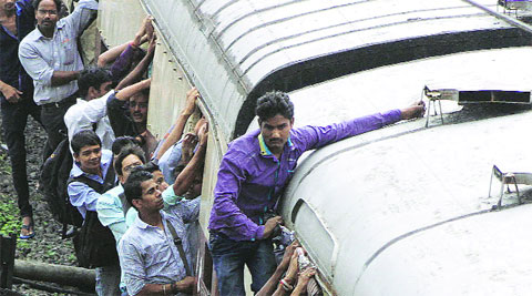 Commuters on a local at Kurla on Tuesday.