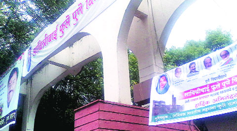 Banners of political parties claim credit for renaming of the university.