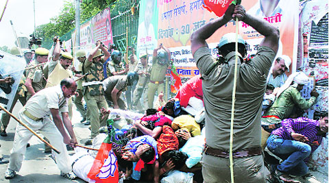 Police cane charge BJP Yuva Morcha activists following a clash between the security personnel and the saffron party workers outside the Vidhan Sabha, in Lucknow on Monday. ( Express photo by: Pramod Singh )
