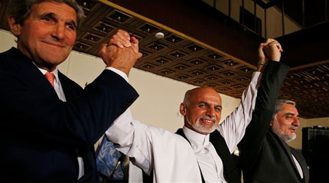 U.S. Secretary of State John Kerry, and Afghanistan's presidential candidates Ashraf Ghani, and Abdulah Abdullah hold their arms in the air together after announcing a deal for the auditing of all Afghan election votes at the United Nations Compound in Kabul. (Source: AP)