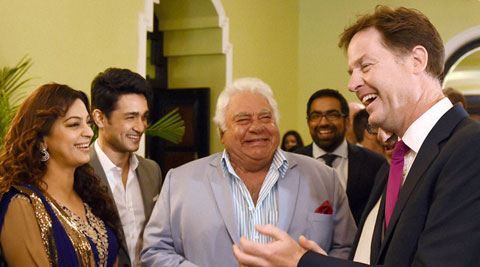 Britain's Deputy PM, Nick Clegg with former Indian cricketer Farokh Engineer and Bollywood actor Juhi Chawla at Taj Mahal Hotel in Mumbai on Tuesday. (Source: PTI)