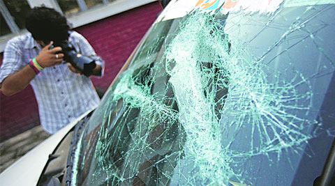 The damaged car of an NSUI leader outside Dr HS Judge Institute of Dental Sciences on UIET campus, Panjab University, on Tuesday. ( Source: Express photo by Sumit Malhotra )