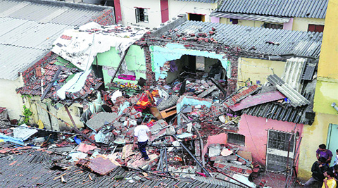 The impact was so severe that along with Kale's house, walls of two adjacent houses were damaged. ( Source: Express photo by Rajesh Stephen )