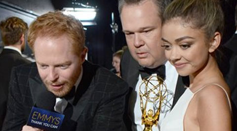 """Jesse Tyler Ferguson, and from left, Eric Stonestreet, and Sarah Hyland pose with the award for outstanding comedy series - """"Modern Family"""" at the 66th Primetime Emmy Awards at the Nokia Theatre L.A. Live on Monday, Aug. 25, 2014, in Los Angeles. (Source: AP)"""