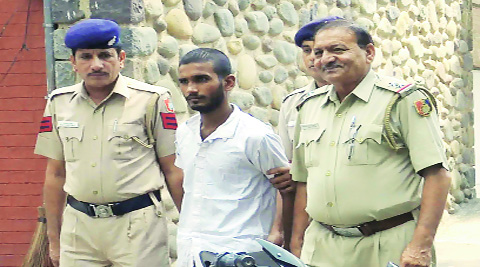One of the snatchers at the Crime Branch in Sector 11, Chandigarh, on Friday. (Source: Express photo)
