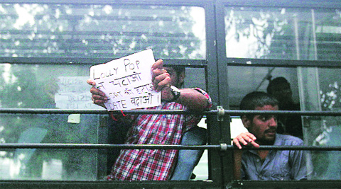 Protesters detained outside Union Home Minister  Rajnath Singh's residence on Tuesday. (Source: Express photo by Tashi Tobgyal)