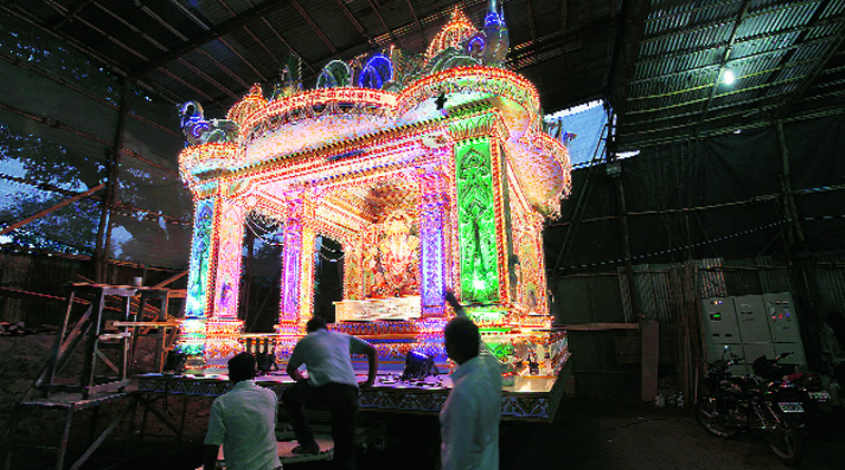 Volunteers of the famous Dagdusheth Ganapati Trust give final touches to the special chariot made for Monday's immersion procession. (Source: Express photo by Pavan Khengre)