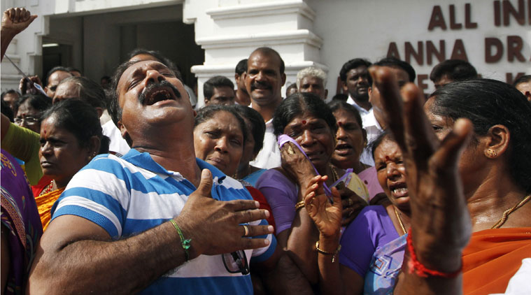 AIADMK) party workers cry after a verdict was handed down to party leader and Tamil Nadu state Chief Minister Jayaram Jayalalitha as a court in Bangalore found her guilty of possessing wealth disproportionate to her known sources of income, in Chennai. (Source: PTI)