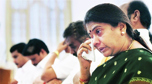Emotional AIADMK leaders during their oath-taking ceremony at Raj Bhavan, on Monday. Source: PTI