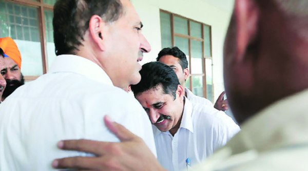 smile is back: Ram Kumar Chaudhary with his brother after his acquittal in Panchkula court on Thursday; (right) Jyoti's father Buti Ram in the court. (Source: Express photo by Jaipal Singh)