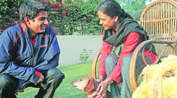 Sanam Singh with mother at their Sector 8 residence in Chandigarh. (R) Sanam in action. (Source: Express Archives)