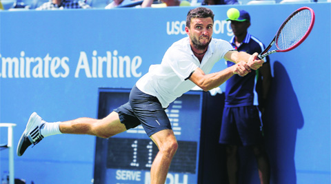 Gilles Simon in action during his 6-3, 3-6, 6-1, 6-3 win over David Ferrer. (Source: AP photo)