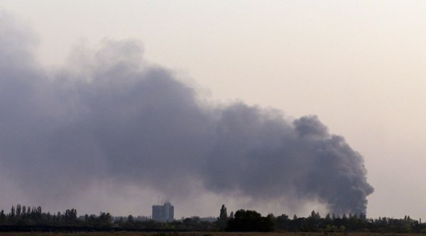 Smoke rises after shelling near the town of Donetsk, eastern Ukraine, Sunday, Sept. 28, 2014.