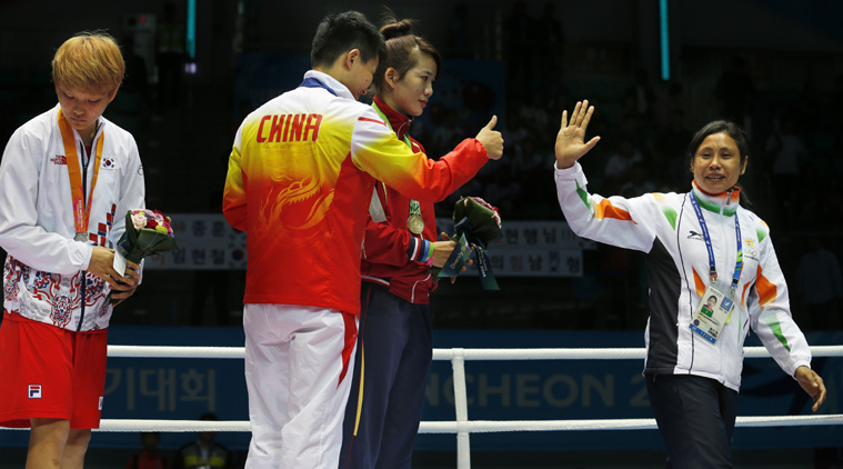 Sarita refused to accept her medal and instead walked up to Ji-Na and put it round her neck, much to the Korean boxer's embarrassment. (Source: AP)