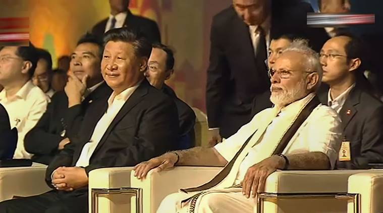 PM Modi and Chinese President Xi Jinping attending a cultural programme at Shore Temple in Mahabalipuram. (PTI)