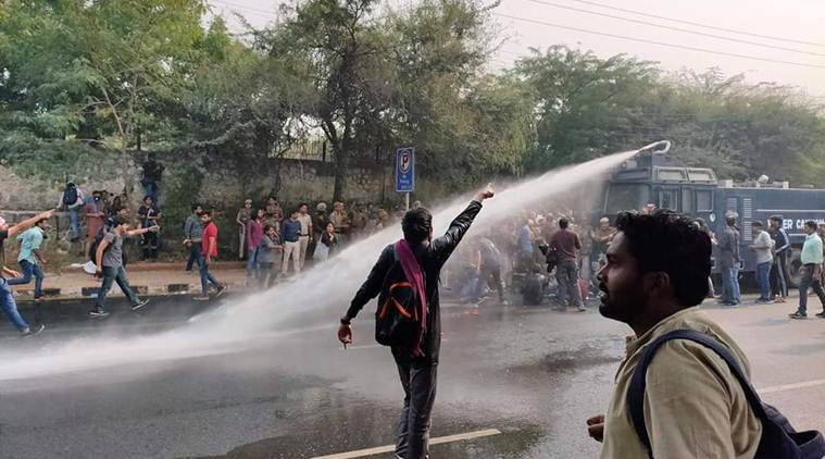 Police use water cannons against protesting students
