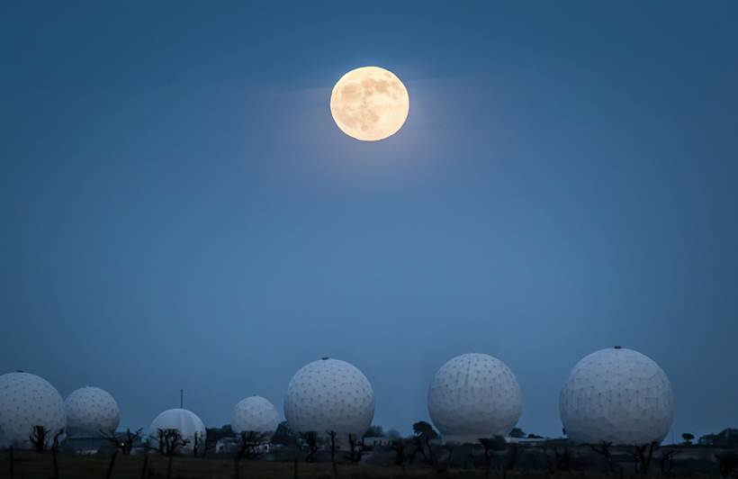 "The wolf moon rises above rises above Menwith Hill RAF station near Harrogate, North Yorkshire, England Friday Jan. 10, 2020. Astronomy enthusiasts are in for a treat on Friday evening as the first full moon of 2020, also known as the ""wolf moon"", coincides with a lunar eclipse. (Danny Lawson/PA via AP)"